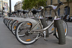 Some bicycles of the Velib bike rental service in Paris. PARIS, FRANCE - OCTOBER 19: Some bicycles of the Velib bike rental service in Paris, France on October Royalty Free Stock Photography