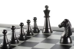 Some Black Chess Pieces. On the Chessboard Stock Photo