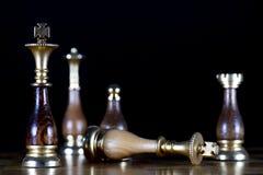 Checkmate the White King. Some Black Chessmen Checkmate the White King Stock Photo