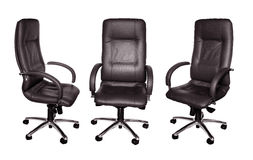 Some black leather armchairs. In different foreshortenings are isolated Royalty Free Stock Image
