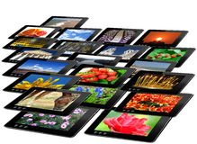 Some black tablets with motley pictures Royalty Free Stock Images