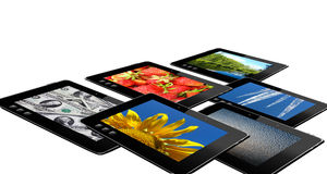 Some black tablets with motley pictures Stock Photography