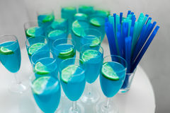 Some blue cocktails with lime on table. Some blue cocktails with lime on the table Royalty Free Stock Image