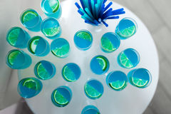 Some blue cocktails with lime on table. Some blue cocktails with lime on the table Royalty Free Stock Photography