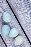 Some blue eggs. Painted eggs on wood. Topical Easter products Stock Photo