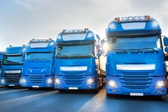 Blue trucks in line composing. Some blue trucks in line composing royalty free stock images