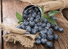 Some Blueberries in a small Bucket. On wooden background (macro shot Royalty Free Stock Image
