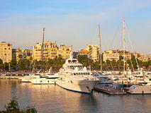 Some boats in  Barcelona port. At the sunset Stock Image