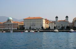 Some boats dock with buildings and church in the center of Trieste in Friuli Venezia Giulia (Italy) Royalty Free Stock Images