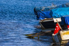 Boats at seaside in the turkish blue aegean sea Royalty Free Stock Photo
