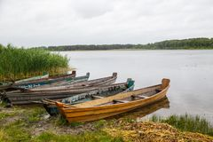 Some boats at the seashore. On a cloudy day royalty free stock photo