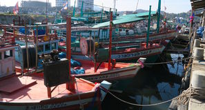 Some boats at a small harbor. In Thailand stock photos