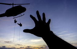 Some body need for help. Some body need for help from a military helicopter rescue stock photo