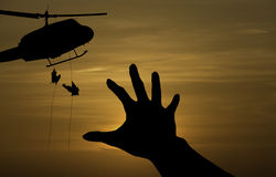 Some body need for help from a military helicopter. Rescue royalty free stock photos