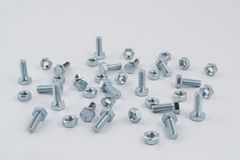 Some bolts and nuts. On a white background Stock Photo