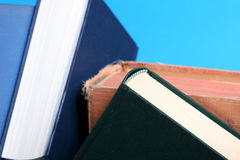 Some books. On blue background Stock Images