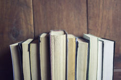 Some books in a bookcase. Close up Royalty Free Stock Photos