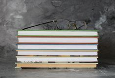 Books and glasses. Some books and glasses on a desk Royalty Free Stock Photos