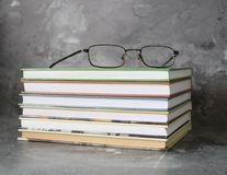 Books and glasses. Some books and glasses on a desk Royalty Free Stock Image