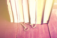 Some books with old style keys on a wooden table. Instagram photo effect Royalty Free Stock Images