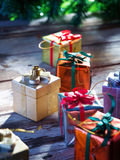 Some boxes. Close up view of christmas  gift boxes  on wooden back Stock Photos