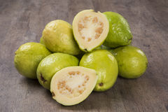 Some brazilian guavas over a striped surface. Some brazilian guavas over a wooden background. Fresh fruits stock photo