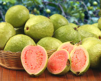 Some brazilian guavas over a striped surface. Stock Image