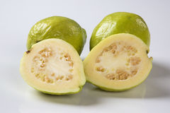 Some brazilian guavas over a white background. Royalty Free Stock Image