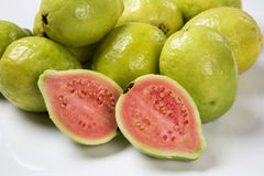 Some brazilian guavas over a white background. Fresh fruits royalty free stock photo