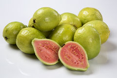 Some brazilian guavas over a white background. Fresh fruits stock image