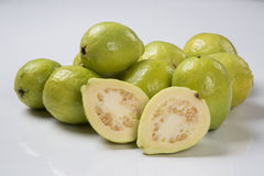 Some brazilian guavas over a white background. Stock Photo