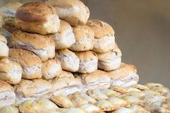 Some bread in a bakery against a dark background. Empty copy space for Editor`s text royalty free stock photography