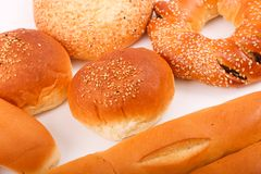Some bread close up. Variety of bakery such as bread, cake, croissant and pâté on white background stock photography