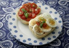 Bread with eggs and tomatoes. Some bread with cooked eggs and tomatoes Royalty Free Stock Photography