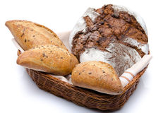 Some breads in a basket. Isolated on white Stock Images