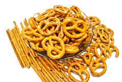 Some breadsticks and salted pretzels. Breadsticks and salted pretzels closeup on white Royalty Free Stock Photo