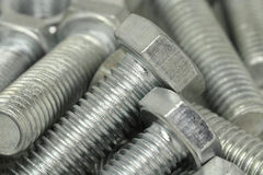 Some brilliant bolts close-up. Abstract background Royalty Free Stock Photos