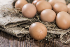 Some brown Eggs in Hey. Some brown Eggs in a heap of Hey Royalty Free Stock Images
