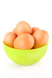 Some brown hen's eggs in plate. Some brown hen's eggs in the plate over the white stock photos