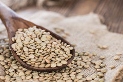 Some brown Lentils. (close-up shot) on wooden background Stock Images