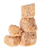 Some brown lump cane sugar cubes. Isolated on white stock photos