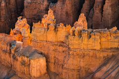 Some Bryce Canyon hoodoos in morning sunshine. This is a photograph of some Bryce Canyon hoodoos in morning sunshine stock photos