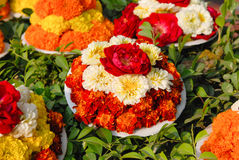 Some buckets of exotic flowers for religious offering in mahabod. Bodh gaya, India , India – February 8, 2006: the rice offering for knighting parade relics of Royalty Free Stock Photos