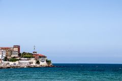 Some buildings over the sea in the coastline of Gijon, Asturias, Spain stock photography