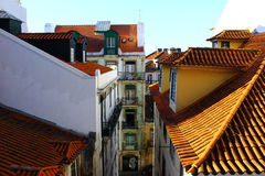 Some buildings and a street at Lisbon, Portugal. Detail of some buildings and a narrow street at Lisbon, Portugal Royalty Free Stock Photography
