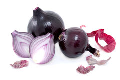 Some  bulb of red onions with  peel. Some  bulb of red onions with red  peel  isolated on white background Royalty Free Stock Photo