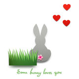 Some bunny loves you. Creative concept photo of a bunny with hearts made of paper on white background Stock Images