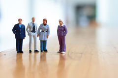 Some busines people on stage. The businesof figure people on stage Royalty Free Stock Photo