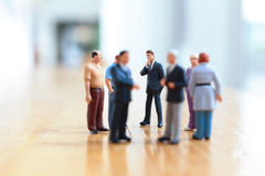 Some busines people on stage Royalty Free Stock Image