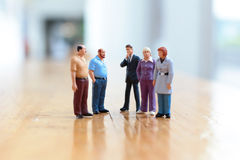 Some busines people on stage. The businesof figure people on stage Royalty Free Stock Image